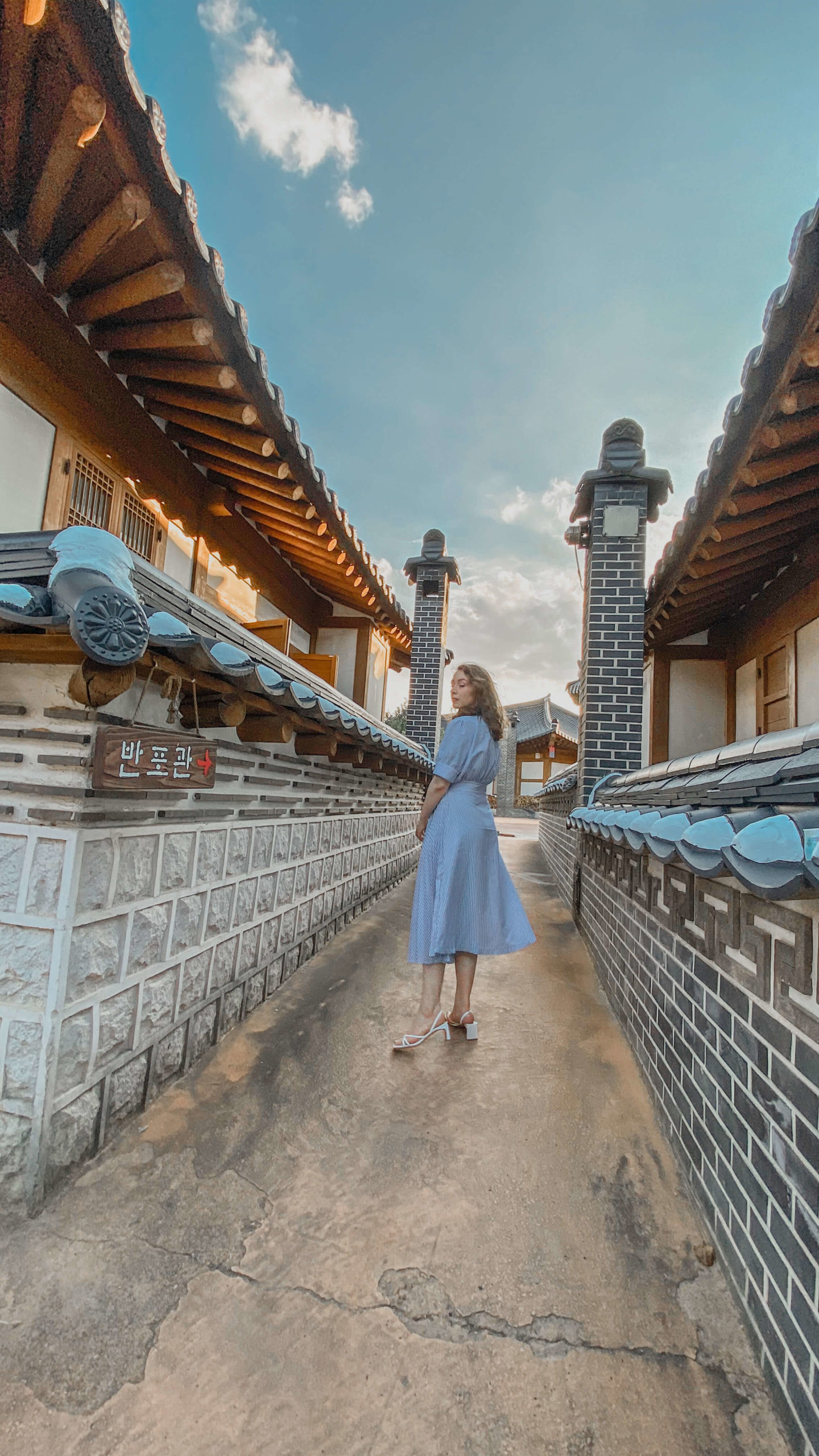 what i wore in gongju city - a blue and white striped wrap dress and white simple heels